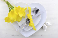 Yellow and white theme wedding table place setting. Stock Photo