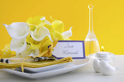 Yellow and white theme wedding table place setting. royalty free stock photos