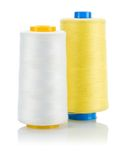 Yellow and white thread on spools isolated Stock Photo