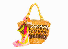 Yellow wicker beach bag with bow isolated on a white background Royalty Free Stock Photos