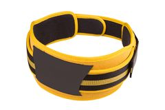 Yellow wide belt for weight lifting and powerlifting, buttoned, isolated on white background isolated. Yellow wide belt for weight lifting and powerlifting stock photos