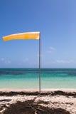 Yellow wind vane at a natural beach Stock Photos