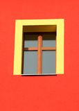 Yellow window. Frame on red house Stock Photography