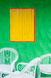 Yellow window and green wall Stock Photography