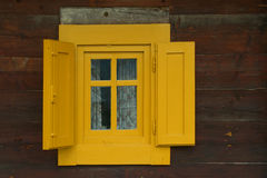 Yellow window. Window on old Serbian house with boards painted bright yellow paint located on Mokra Royalty Free Stock Image