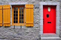 Yellow window Red door Stock Photography