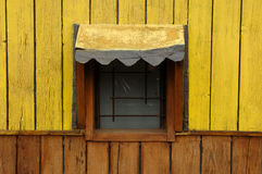 Yellow window of a wooden cottage stock photography