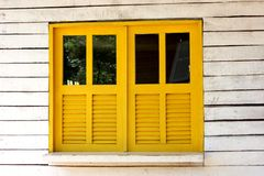 Yellow window. Yellow wooden window and glass details in cottage Stock Photo
