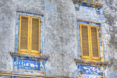 Yellow windows. In a grunge wall. Processed for hdr tone mapping effect Stock Image