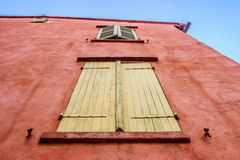 Yellow windows on red building Royalty Free Stock Images