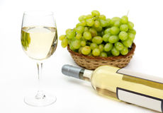 Yellow wine with grapes Royalty Free Stock Photos