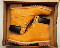 Yellow winter boots in the box. Closeup view Stock Photo
