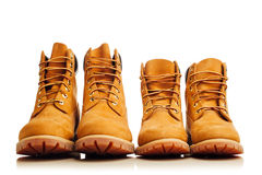 Yellow winter boots. On white Stock Photos