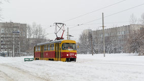 Yellow Winter Tram and Snow in Russian Winter Stock Photo