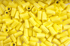 Yellow wire nuts. Yellow wirenuts used for connecting 12 gauge wire in household circuits as a background Royalty Free Stock Photos