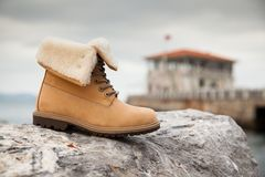 Yellow women`s boots royalty free stock image
