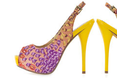 Yellow women stiletto shoes, on white Royalty Free Stock Image
