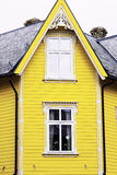 Yellow wood house front  two windows Stock Photography