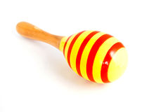 Yellow wood maracas with red stripe isolated. On white background royalty free stock image