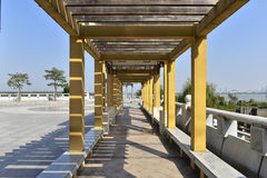 Yellow wood roofed corridor Royalty Free Stock Photo