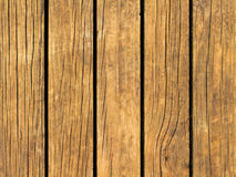 Yellow wood texture with vertical lines. Warm brown wooden background for natural banner. Royalty Free Stock Photos