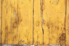 Yellow wooden background. Old wooden background with a rough yellow painting on it Royalty Free Stock Photo
