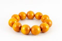 Yellow wooden beads bracelet Stock Photo