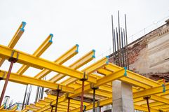 Free Yellow Wooden Beams For Monolithic Building Construction Stock Photo - 167595330