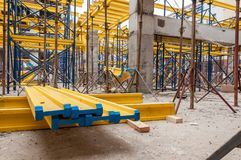 Free Yellow Wooden Beams For Monolithic Building Construction Royalty Free Stock Images - 167595339