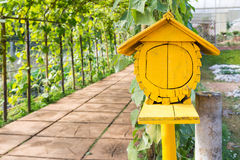 Yellow wooden bird house Royalty Free Stock Images