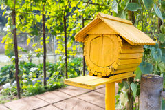 Yellow wooden bird house Stock Image