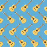 Yellow wooden cartoon guitar seamless pattern background for des Royalty Free Stock Photo