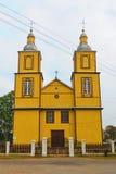 Yellow wooden church, Lithuania Stock Photo