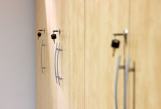 Yellow wooden closets with black keys plugged in Royalty Free Stock Image