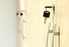 Yellow wooden closets with black keys plugged in. Photo of yellow wooden closets with black keys plugged in.Small depth of field royalty free stock photo
