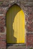 Yellow wooden cottage door Stock Photo