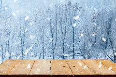 Yellow wooden desk top and winter landscape Stock Images