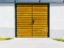 Yellow wooden door outside. Stock Image