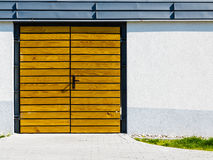 Yellow wooden door outside. Royalty Free Stock Images