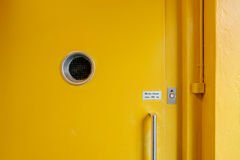 Yellow Wooden Door With Round Hole Royalty Free Stock Images