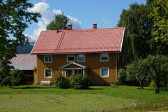 Yellow wooden farm and blue sky, Norway Stock Photos
