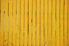 Yellow Wooden Fence Background. A photograph of a yellow wooden fence background stock photo