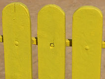 Yellow wooden fence Stock Photo