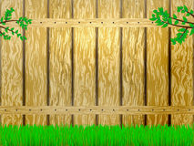 Yellow wooden fence and green grass. Vector illustration of yellow wooden fence and green grass. Branch with green leaves Royalty Free Stock Image