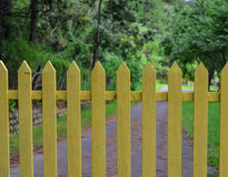Yellow wooden fence with walkway in forest Royalty Free Stock Image