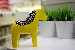 Yellow wooden horse Stock Image