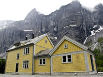 A yellow wooden house in Andalsnes, Royalty Free Stock Images