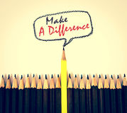 Yellow wooden pencil arrange with make a difference concept. The yellow wooden pencil arrange with make a difference concept royalty free stock image