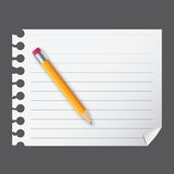 Yellow wooden pencil on a blank notepad Stock Photos