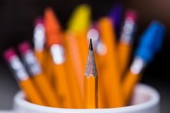 2 Yellow wooden Pencils in a Cup with a very shallow depth of f Royalty Free Stock Photo